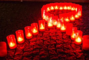 Candles form a red ribbon in Berlin, on November 30, 2013 during the World Aids Day. AFP Photo /DPA / Florian Schuh/ GERMANY OUT